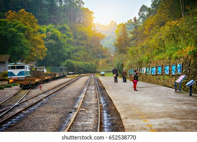Local people wait for the train on the platform to Bagou at early morning time. Mifenguan. Jiayang Mining Region. Sichuan province. China.