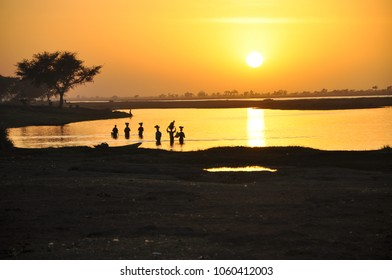 Local people washing clothes in Niger river