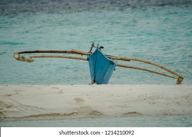 Local philippine boat with booms on a beach of Camiguin Island