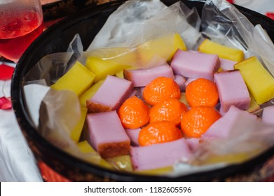 Local popular Nyonya kuih is come in different shapes, colours, texture and designs, are bite-sized snack or dessert foods originating from Malaysia. slice and display in a basket ready to eat.
