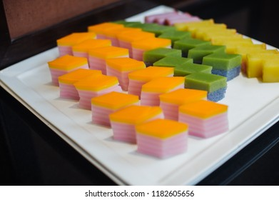 Local popular Nyonya kuih is come in different shapes, colours, texture and designs, are bite-sized snack or dessert foods originating from Malaysia. slice and display in a plate ready to eat.