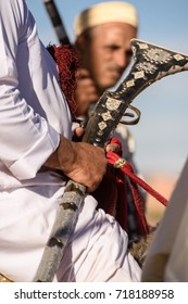 Local rider holds an old gun while participates in a traditional fantasia event (or MOUSSEM in Arabic)