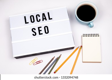 Local SEO. Text in lightbox. White desk with stationery