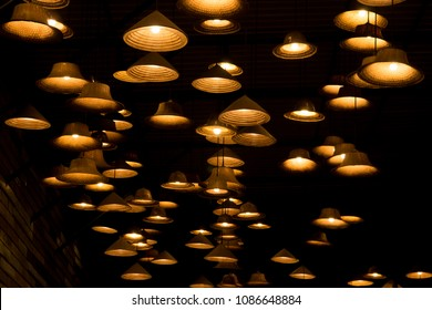 Local shaped lamps on ceiling against dark background