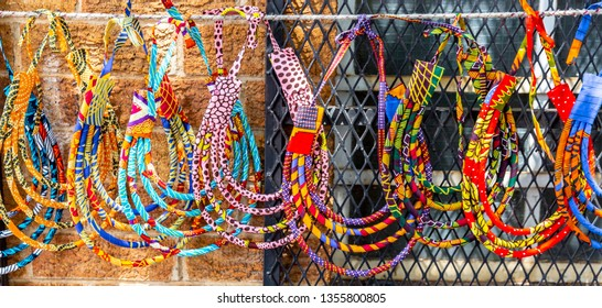 Local street market in South Africa. handmade colorful beads bracelets, bangles. Craftsmanship. African fashion. Traditional ornament, accessories.
