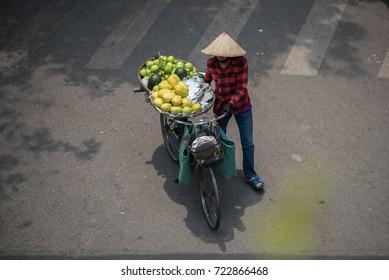 Local street vendor in Hanoi street, Vietnam