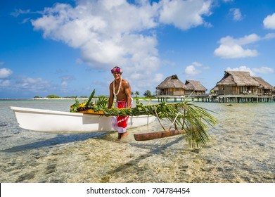 Local tahitian man was canoeing for food delivery in Tikehau island resort in French polynesia.