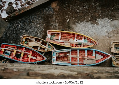 Local traditional fishing boats under shalter during storm in atlantic ocean. View from above, view top-down. Sinagoga location on Santo Antao Island. Cape Verde