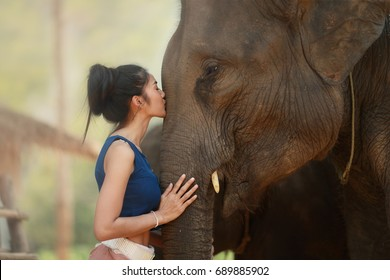 The local woman kiss her best friend elephant with love and stay in the great relationship.