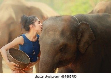 The local woman is taking care her best friend elephant with love and stay in the great relationship.