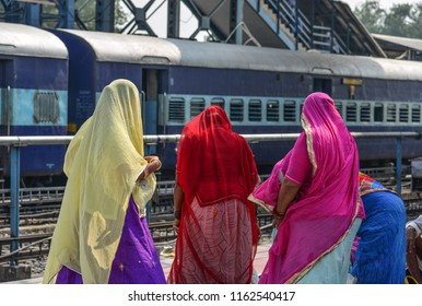 Local women waiting at railway station in Ajmer, India. India Railway is the fourth-largest railway network in the world by size.