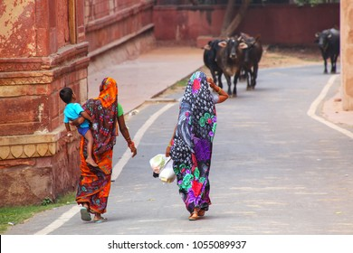 Local women walking along the wall of Taj Mahal complex in Agra, Uttar Pradesh, India. Agra is one of the most populous cities in Uttar Pradesh