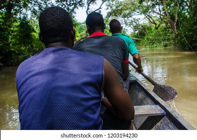 Locals on a canoe drive in the forest, eco village close to Mole National Park, Ghana.