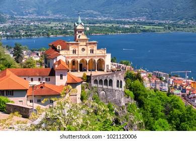 LOCARNO, SWITZERLAND - May 15, 2016 - Madonna del Sasso Church above Locarno city, lake Maggiore (Lago Maggiore) and Swiss Alps in Ticino, Switzerland.