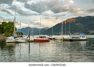 Locarno, Switzerland - September 1, 2018: Small boats on Lago Maggiore in Locarno, Switzerland during summer evening