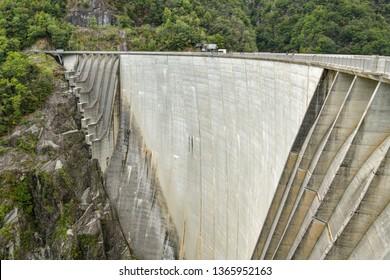 Locarno, Switzerland - September 1, 2018: Verzasca Dam in Val Verzasca near city of Locarno in Switzerland, popular bungee jumping spot in Ticino during summer