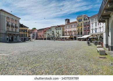 Locarno, Switzerland, square Grande (piazza Grande) with shops and restaurants located in the historic center of the city. Locarno is an important tourist city located on lake Maggiore