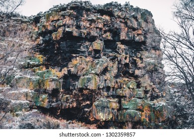 Located along the roadways in Twin Falls, these cliffs display colorful growths of algae and a light dusting of new snow. The rocks provide visual interest and attract rock-climbing enthusiasts.