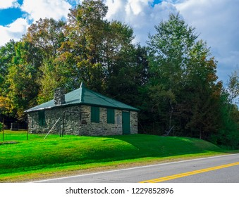 It is located near a small English-speaking cemetery. The shutters are set for not what we see inside. Photo taken in the Eastern Townships, Quebec, Canada; October 6, 2017.