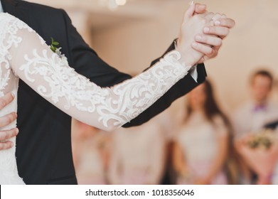Location of hands of the newlyweds in the first wedding dance.