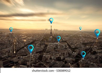 Location pin above cityscape and network connection concept at Paris, France.