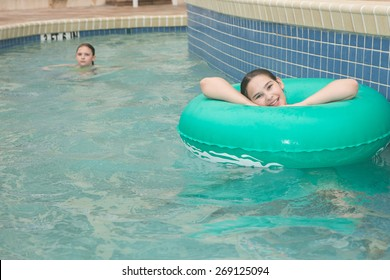 Location shot of a  young girl on a blue/green innertube in a lazy river in Myrtle Beach South Carolina