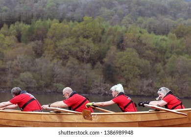 LOCH AWE, ARGYLL, SCOTLAND, UK : 28 APRIL 2019 : The skiff from Arran Rowing Club in action on the water and were the overall Winners of the Loch Awe Adventure and Dalavich Regatta