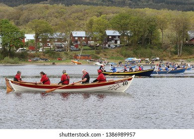 LOCH AWE, ARGYLL, SCOTLAND, UK : 28 APRIL 2019 : Skiffs try and form a line on the water at the start of the Loch Awe Adventure Race with Dalavich Village in the background