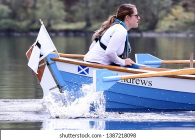 LOCH AWE, ARGYLL, SCOTLAND, UK : 28 APRIL 2019 : The female coxswain of the St Andrews skiff in action on Loch Awe during the Dalavich Regatta