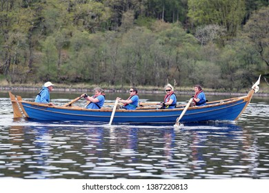 LOCH AWE, ARGYLL, SCOTLAND, UK : 28 APRIL 2019 : The North Queensferry crew and skiff in action on Loch Awe during the Dalavich Regatta