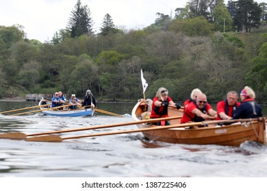 LOCH AWE, ARGYLL, SCOTLAND, UK : 28 APRIL 2019 : The St Andrews skiff leading the 1st Leg of the race from the Arran crew on Loch Awe during the Dalavich Regatta