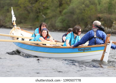 LOCH AWE, ARGYLL, SCOTLAND, UK : 28 APRIL 2019 : The crew of the Kinghorn skiff in action on Loch Awe during the Dalavich Regatta