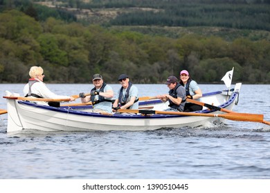 LOCH AWE, ARGYLL, SCOTLAND, UK : 28 APRIL 2019 : The crew of the KIlchrenan Inverinan & Dalavich skiff named Mingulay in action on Loch Awe during the Dalavich Regatta