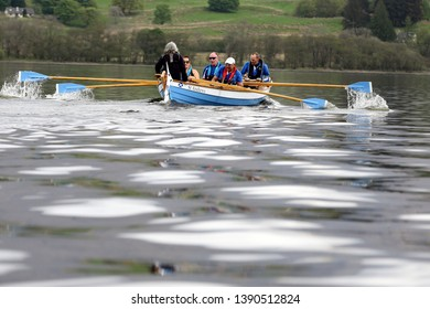 LOCH AWE, ARGYLL, SCOTLAND, UK : 28 APRIL 2019 : The St Andrews skiff on Loch Awe during the Dalavich Regatta