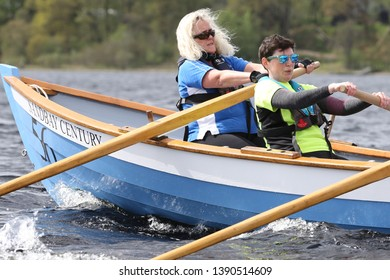 LOCH AWE, ARGYLL, SCOTLAND, UK : 28 APRIL 2019 : Two female rowers belonging to a skiff crew put the hard work and effort in during the Dalavich Regatta on a Loch Awe