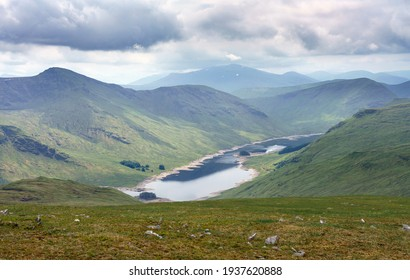 Loch Daimh with the mountain summits of Stuc an Lochain, Meallan Odhar to the left and Sron A Choire Chnapanaich in the distance in the Scottish Highlands, UK landscapes.