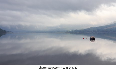 Loch Fyne lies like a mirror in the highlands of Scotland, UK.