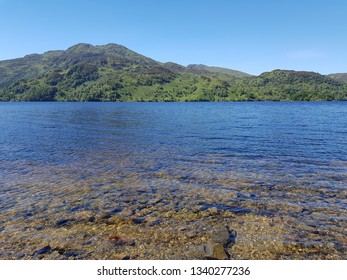 Loch Katrine,Scotland-July 2018.This photo depicts the crystal clear waters of Loch Katrine. It is one of the freshwater Scottish lochs in the centre of Loch Lomond & The Trossachs National Park.