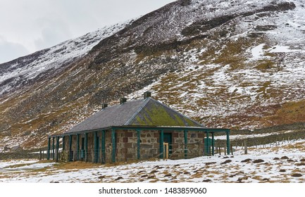 Loch Lee, Scotland - 12th March 2013: An old abandoned Hunting Bothy at Glen Esk in the Angus Glens on a snowy cold winters day one March.
