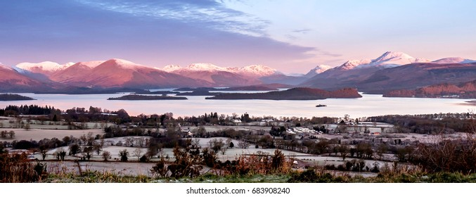 Loch Lomond Panorama with a background of Luss Hills, Arrochar Hills and Ben Lomond, seen from Duncryne Hill, Gartocharn ( The Dumpling ), Scotland on a cold winter morning.