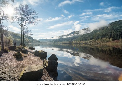 Loch Lubnaig, a part of the Loch Lomond & Trossachs National Park in Scottish Highlands. Reflection of Tree and Mountain on water, in Autumn.