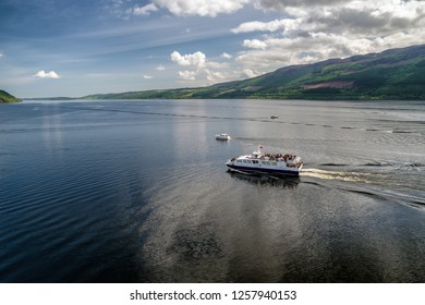 LOCH NESS, SCOTLAND, MAY 23: Cruise ship on lake Loch Ness full of tourists on May 23, 2018 in Loch Ness
