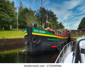 Loch Ness, UK - September 3, 2019: Dutch hotel barge Ros Crana exits a lock on the Caledonian Canal in the Scottish Highlands, Scotland.