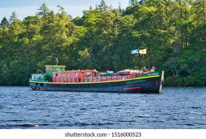 Loch Ness, UK - September 8, 2019: Dutch hotel barge Ros Crana enters Loch Ness on the Caledonian Canal in the Scottish Highlands, Scotland.
