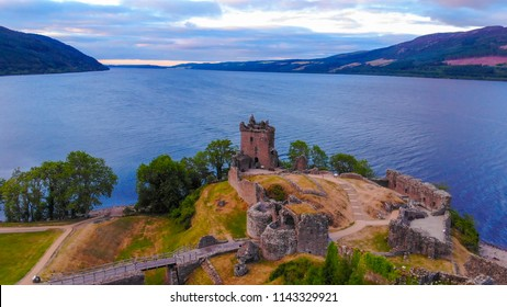Loch Ness and Urquhart Castle in the evening - aerial view