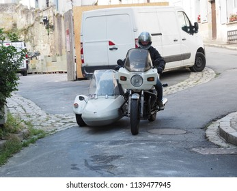 Loches, France - June 8, 2018. A man drives a motorcycle with sidecar.