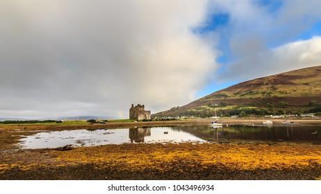 Lochranza Castle and the loch in cloudy day, Isle of arran, Scotland, UK
