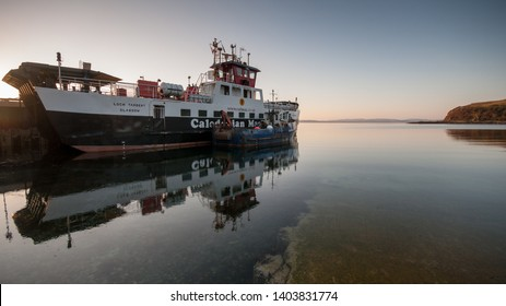 Lochranza, Scotland, UK - June 2, 2011: A CalMac car ferry is docked at the pier in Lochranza Bay on Arran, one of the islands of the Firth of Clyde in the west of Scotland.