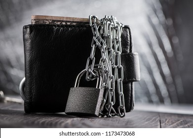 Lock concept of money protection.Wallet crossed by metal chain.Finance success, investment.