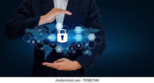 lock In the hands of a businessman Shield the shield to protect the cyberspace.Space input data Data Security Business Internet Concept. Secure information World map lock prevent hand